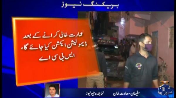 A building in Karachi starts tilting