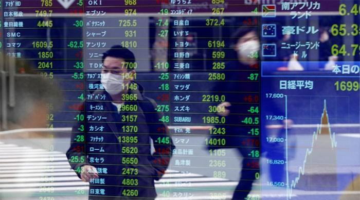 Asian shares cautiously gain on virus hopes, dollar slips