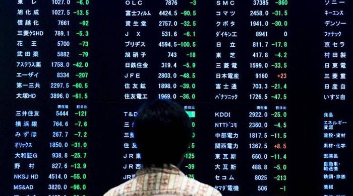 Asian markets mostly down as traders fret over virus