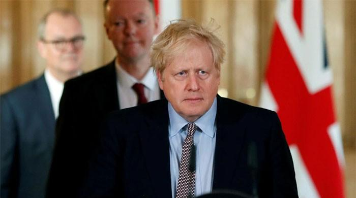 UK PM Boris Johnson 'improving', 'sitting up in bed' as he fights COVID-19 in ICU