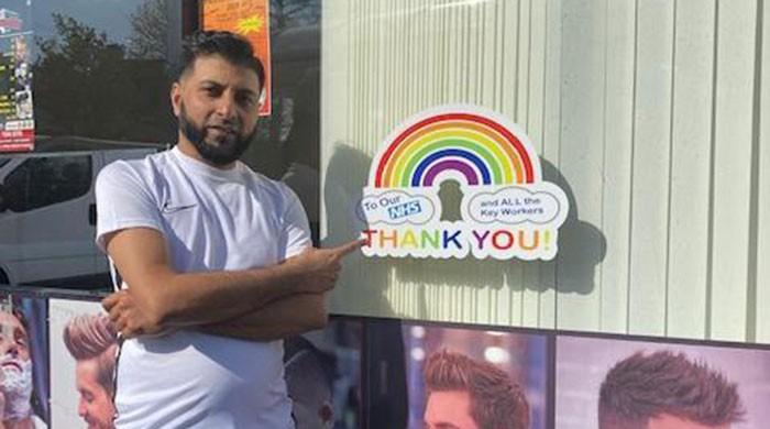 British-Pakistani barber raises money for NHS by selling rainbow stickers