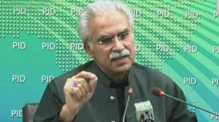 Wearing facial masks in public places is mandatory now: Dr Zafar Mirza