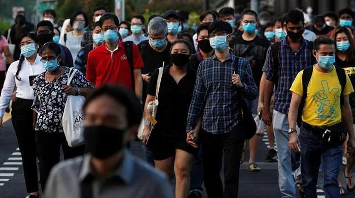 Singapore mulls issuing wearable virus-tracing device for all citizens