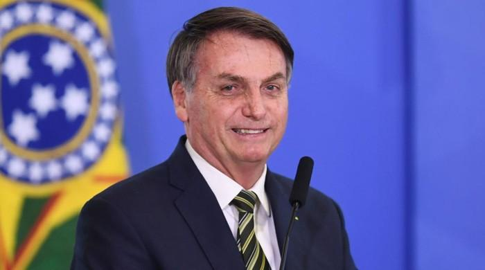 President Jair Bolsonaro threatens to pull Brazil from WHO