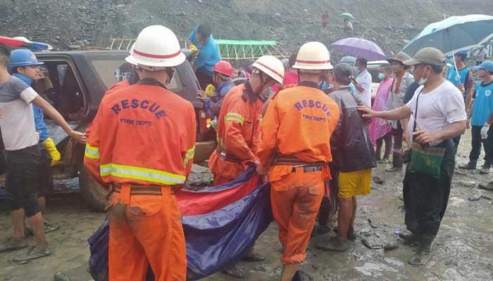 At least 100 dead in landslide at Myanmar jade mine
