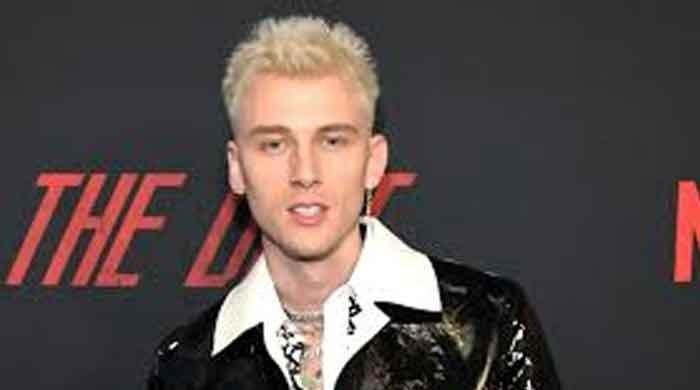Machine Gun Kelly cancels 'Hotel Diablo' anniversary plans after father's death