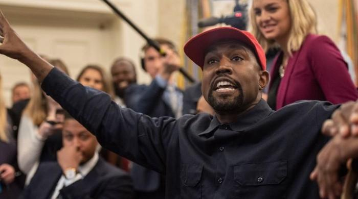 Kanye West back-pedals on his support for Trump: 'I am taking the red hat off'