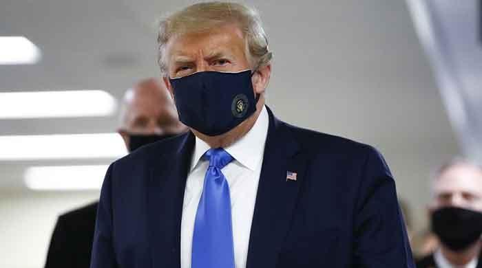 In a first, Trump covers face with mask in public as coronavirus cases surge in US