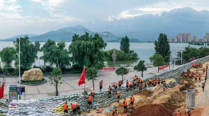 China erects sandbag flood barriers after record rainfall