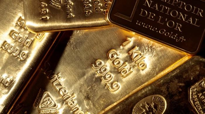 Gold soars to record high as investors rush into safe-haven commodity