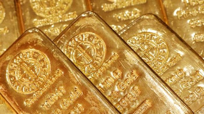 Gold strikes another record high, equity markets struggle with mounting virus fears