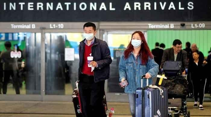 Coronavirus quarantine: Singapore to make travellers wear monitoring device