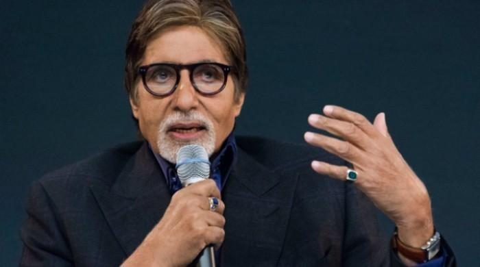 Amitabh Bachchan slams troll attacking him for not donating