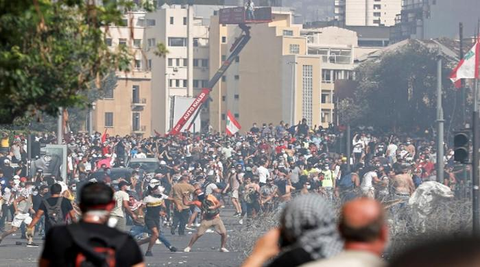 Shots, tear gas and flames as anti-govt protests after Beirut explosion grow