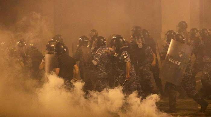 Lebanon: Protests rage against ruling class in Beirut after two ministers resign
