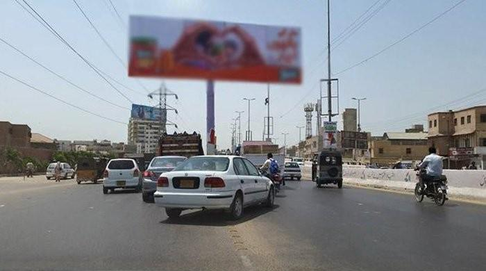 Billboards removed from Karachi Saddar's mobile market after court orders