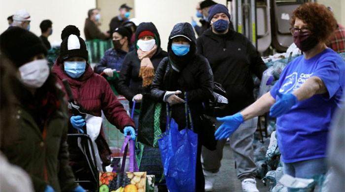 US faces a smoldering COVID-19 pandemic nationwide as flu season starts