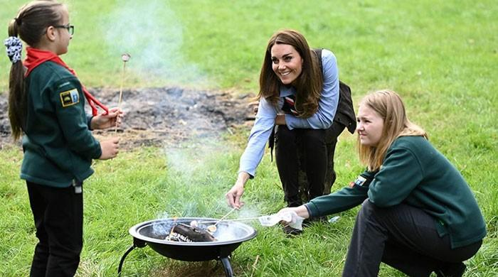 Kate Middleton toasts marshmallows as she enjoys outdoor activities with Scouts: Watch