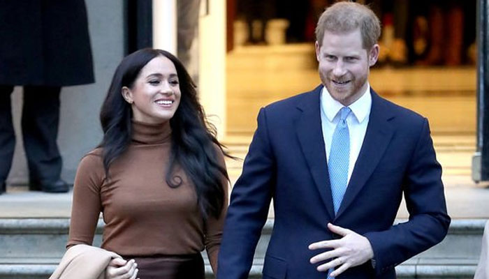 Prince Harry and Meghan Markle receive apology over 'illegal' photos of son