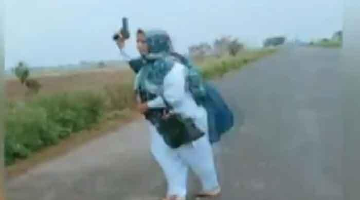 Video of Sialkot lady health worker firing shots into the air goes viral