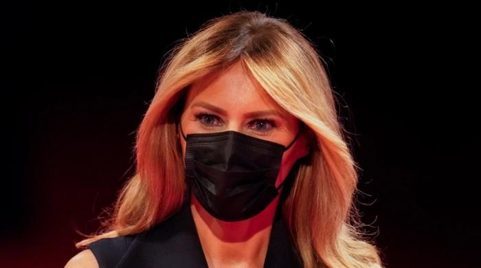 In pictures: Melania Trump stuns in black dress, matching face mask