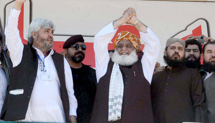 Chief of Jamiat Ulema-e-Islam (JUI-F), Maulana Fazal-ur- Rehman along with others are waving hands to their supporters during the public gathering meeting of Pakistan Democratic Movement (PDM) held at Ayub Stadium in Quetta on Sunday, October 25, 2020. — PPI