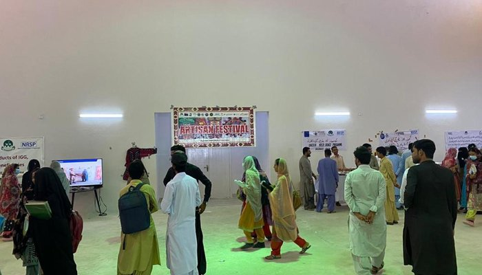 People visit the stalls set up during the Dukhtaran-e-Pakistan (Daughters of Pakistan) National Conference at the Balochistan's University of Turbat. — Geo.tv