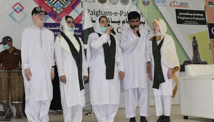 People singing national songs during the Dukhtaran-e-Pakistan (Daughters of Pakistan) National Conference at the Balochistan's University of Turbat. — Geo.tv