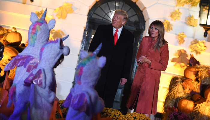 US President Donald Trump and First Lady Melania Trump give out candy to children at a Halloween celebration at the White House in Washington, US, October 25, 2020. AFP/Olivier Douliery