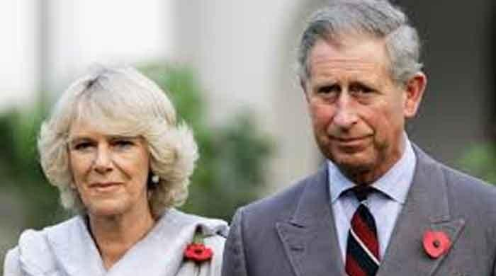 Co-writer of James Bond theme song receives award from Camilla, Duchess of Cornwall