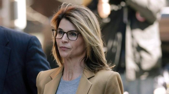 Lori Loughlin reports to prison to serve two-month sentence in college scandal