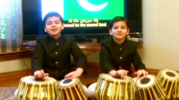 Two young brothers who brought the music of Geo headlines to the beat of the drum