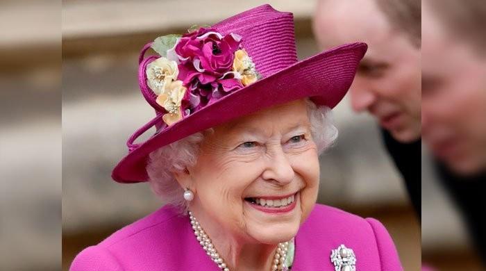 'Queen enjoys getting hands wet in the sink'