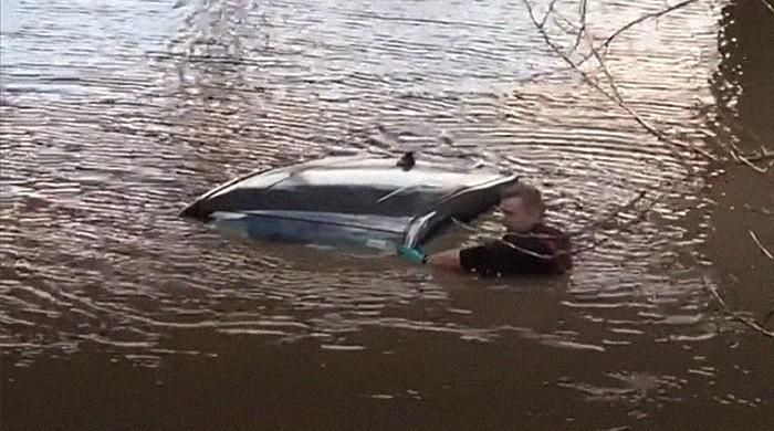 WATCH: UK couple saved two hours after car drowns in freezing cold floodwater