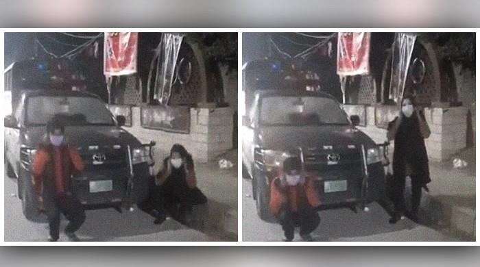 Viral video shows Lahore siblings doing-sit ups in front of a police vehicle