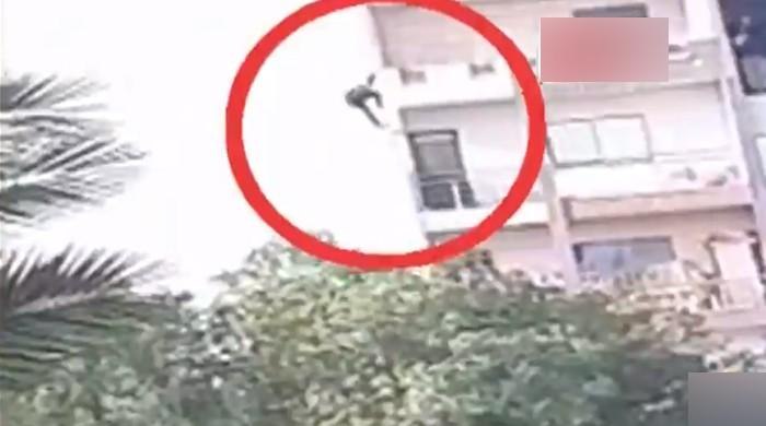 Karachi woman throws child down from multi-storey building before leaping off herself