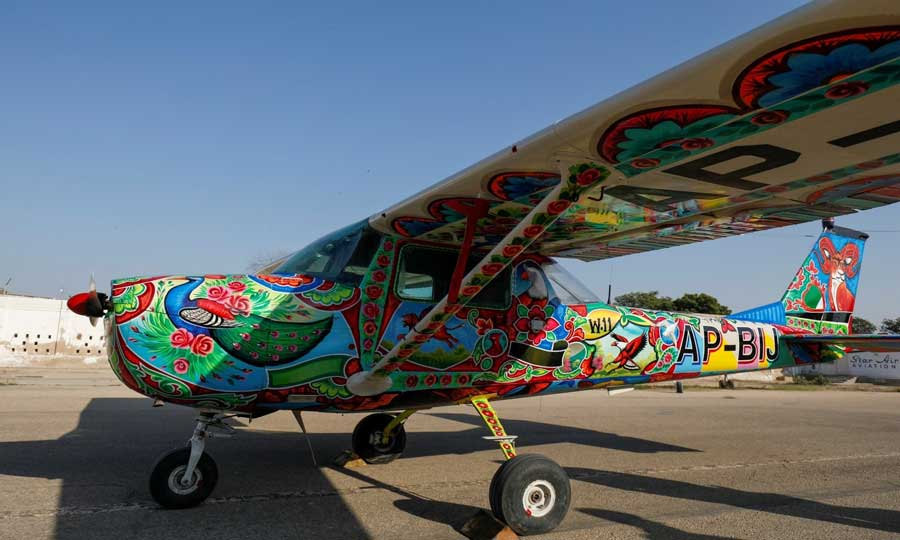 A two-seater Cessna aircraft painted with Pakistani truck art is seen at Jinnah International Airport, Karachi, Dec 30, 2020. — Reuters