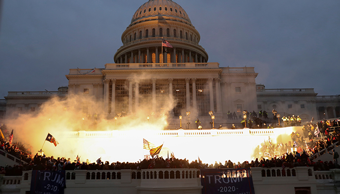 An explosion caused by a police munition is seen while supporters of U.S. President Donald Trump gather in front of the U.S. Capitol Building in Washington, U.S., January 6, 2021. — Reuters