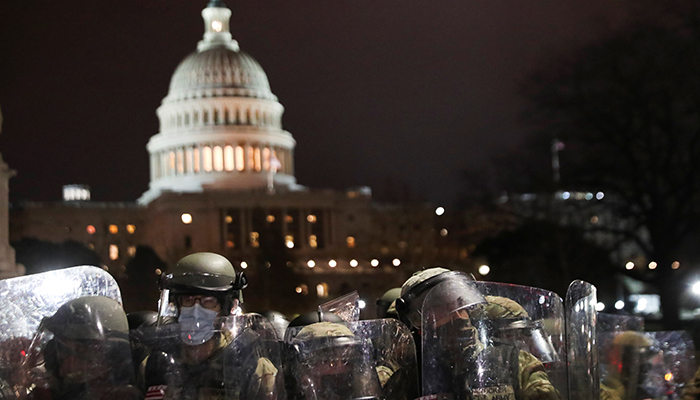 Members of the National Guard stand guard as supporters of U.S. President Donald Trump gather outside the U.S. Capitol building during a protest against the certification of the 2020 U.S. presidential election results by the U.S. Congress, in Washington, U.S., January 6, 2021. — Reuters