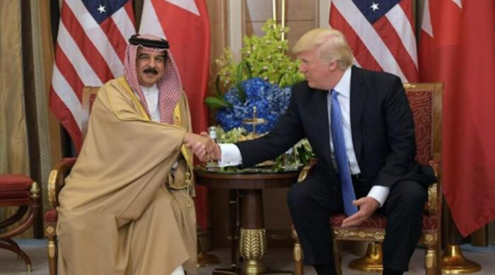 On last full day in office, Trump decorates Bahrain king with rare award