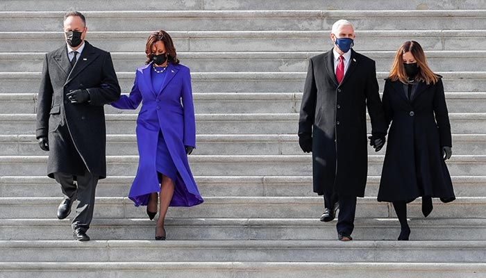 Former U.S. Vice President Mike Pence and his wife Karen and U.S. Vice President Kamala Harris and her husband Doug Emhoff walk down the stairs after the inauguration of Joe Biden as the 46th President of the United States, in Washington, U.S., January 20, 2021. — Reuters