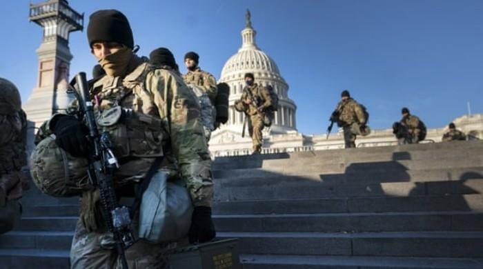 Dozen US National Guard troops removed from duty after scrutiny ahead of inaugural ceremony