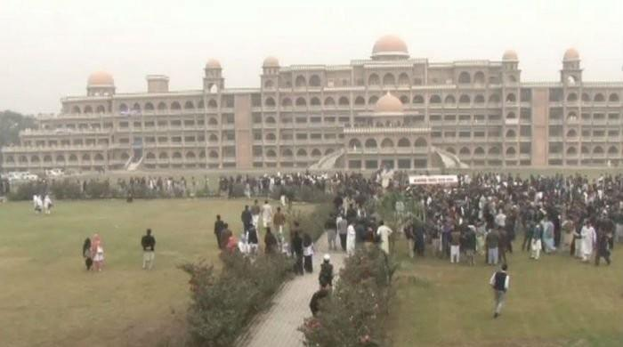 Protesting Peshawar University students demand online exams