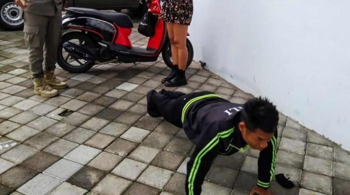 Coronavirus: Foreigners in Bali made to do push-ups for not wearing face masks