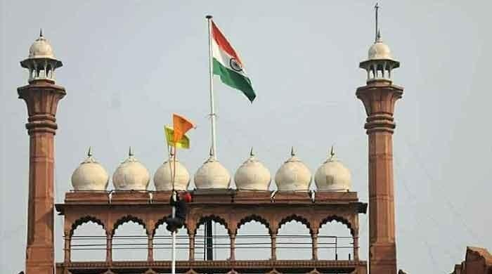 Chaos in New Delhi as protesting farmers hoist their flag on Red Fort