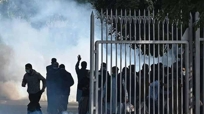 Police fire tear gas at protesting government employees in Islamabad