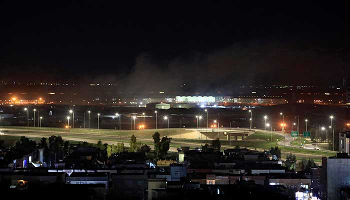 Smoke rises over the Erbil after reports of mortar shells landing near Erbil airport in Iraq