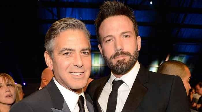 Ben Affleck looks happy with his pal George Clooney after a painful split from Bond girl Ana de Armas