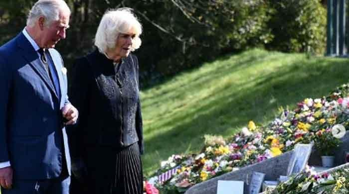 Prince Charles, Camilla view flowers left by people in memory of Prince Philip