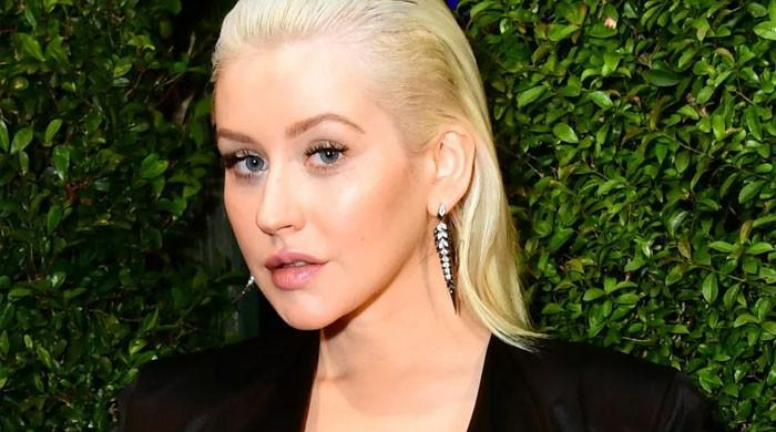Christina Aguilera touches on 'insecurity' over 'super skinny' past photos